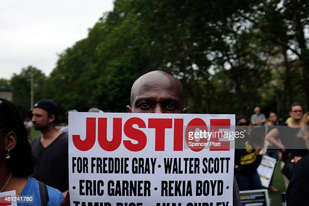 People attend a rally in Brooklyn to call for justice for Eric Garner one year after he died in an apparent police chokehold on July 18 2015 in New...