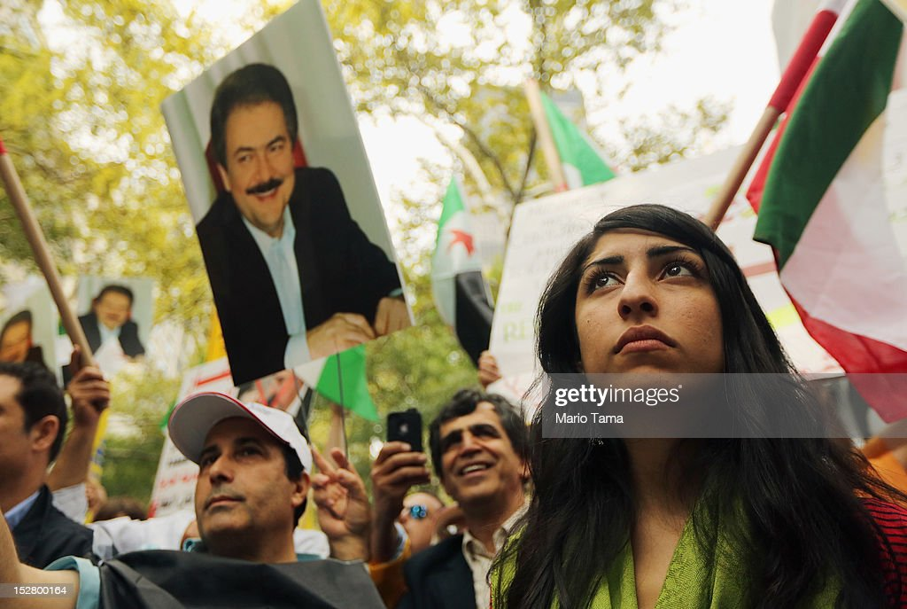 People attend a rally of groups opposing Iranian President Ahmadinejad's speech at the United Nations General Assembly on September 26, 2012 in New York City. Politicians including former New York Mayor Rudolph Giuliani, former House Speaker Newt Gingrich, former Homeland Security Secretary Tom Ridge, former New Mexico Governor Bill Richardson and former U.N Ambassador John Bolton spoke at the pro-democracy rally which also included Syrian pro-democracy protesters.