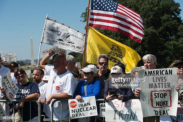 People attend a rally organized by the Tea Party Patriots against the Iran nuclear deal in front of the Capitol in Washington DC on September 9 2015...