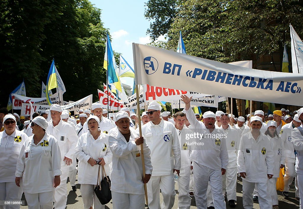 "People attend a rally organized by the trade union of atomists and nuclear workers in Kiev, Ukraine, May 31, 2016. Participants demanded to deblock accounts of state enterprise National Nuclear Energy Generating Company ""Energoatom"", which were earlier arrested due to debts, according to organizers."