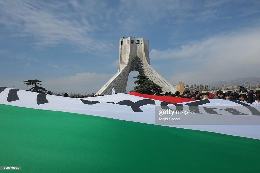 People attend a rally to mark the 37th anniversary of the Islamic revolution in Azadi Square (Freedom Square) on February 11, 2016 in Tehran, Iran. Rallies and celebrations are being held across the country. President Hassan Rouhani has urged the public to turn out for the upcoming parliamentary and Constitutional Council elections.