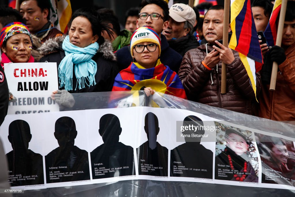 People attend a rally to mark the 55th anniversary of the Tibetan national uprising outside the United Nations buiding on March 10, 2014, in New York City. On this day in 1959, an uprising against China's occupation of the autonomous region of Tibet took place, forcing spiritual leader the Dalai Lama to flee into exile.