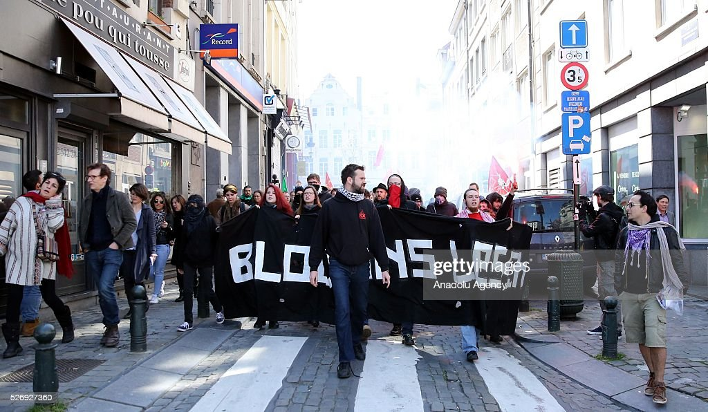 People attend a rally to mark the International Labor Day at the Place Rouppe in Brussels, Belgium on May 1, 2016.