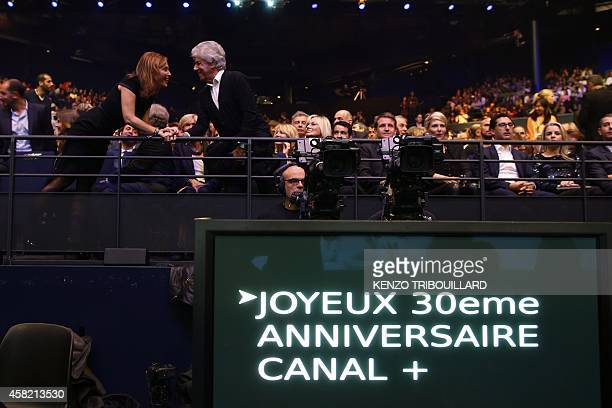 People attend a show celebrating the 30 years of the French TV Canal on October 31 2014 in Paris AFP PHOTO / KENZO TRIBOUILLARD