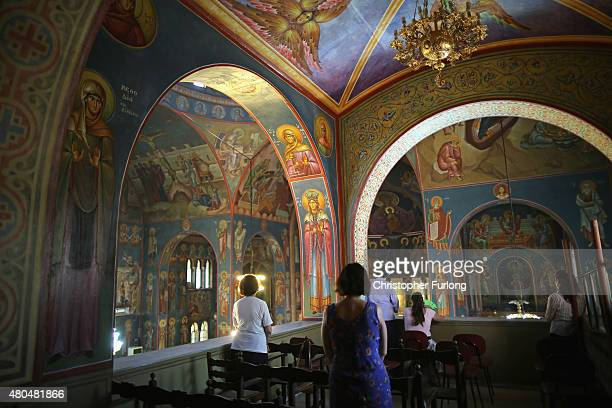 People attend a Sunday morning church service in an orthodox church on July 12 2015 in Athens Greece The people of Greece continue their daily life...