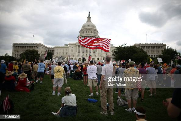 People attend a Tea Party rally in front of the US Capitol June 17 2013 in Washington DC The group Tea Party Patriots hosted the rally to protest...