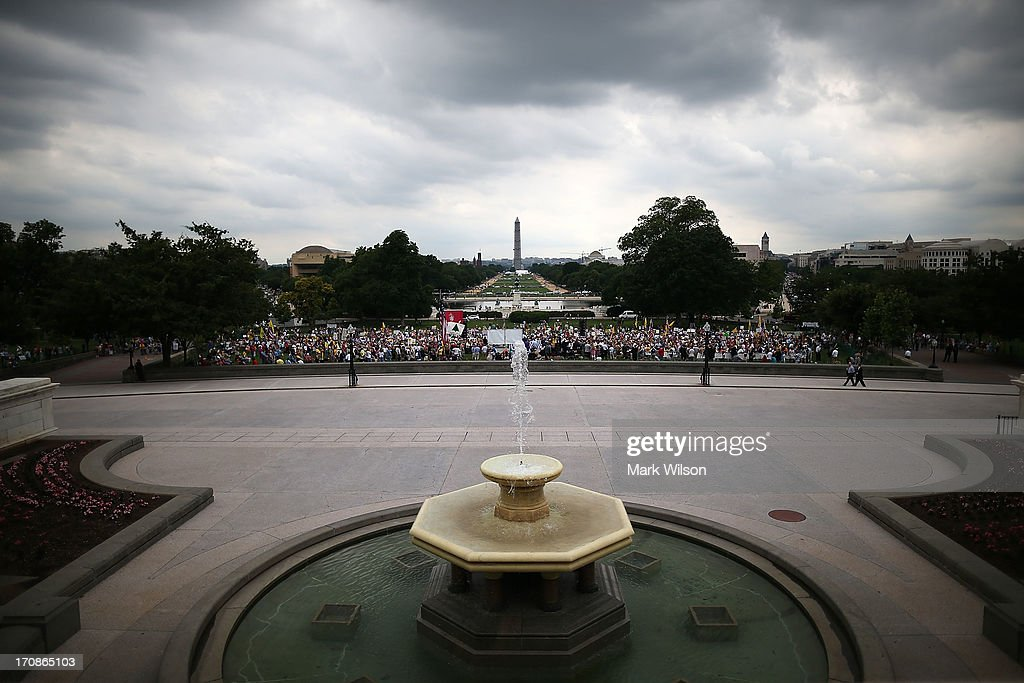 People attend a Tea Party rally in front of the U.S. Capitol, June 17, 2013 in Washington, DC. The group Tea Party Patriots hosted the rally to protest against the Internal Revenue Service's targeting Tea Party and grassroots organizations for harassment.