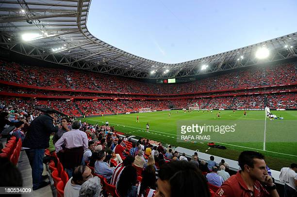 People attend a training session of Athletic Bilbao football team at the new San Mames stadium in the Northern Spanish Basque city of Bilbao on...