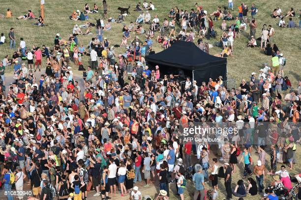People attend a twoday meeting organised by opponents to a controversial international airport project in the area on July 8 in NotreDamedesLandes...