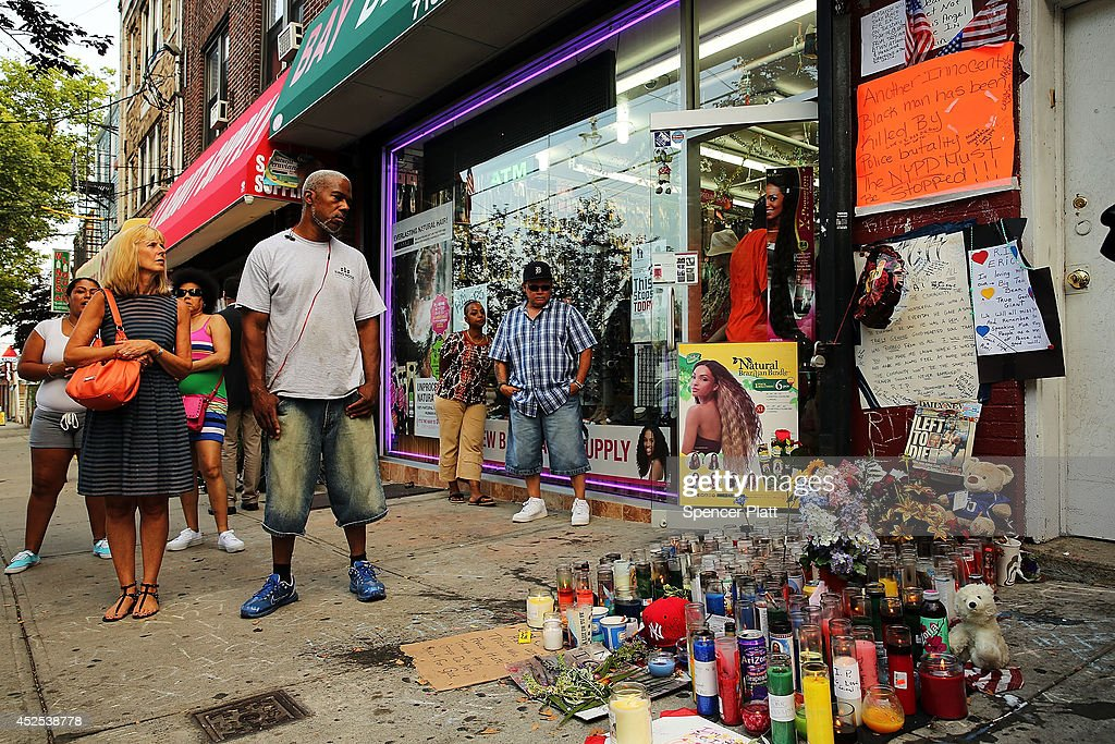 People attend a vigil for Eric Garner near where he died after he was taken into police custody in Staten Island last Thursday on July 22 2014 in New...