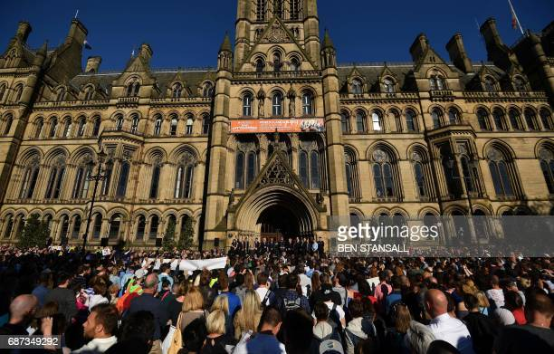 People attend a vigil in Albert Square in Manchester northwest England on May 23 in solidarity with those killed an injured in the May 22 terror...