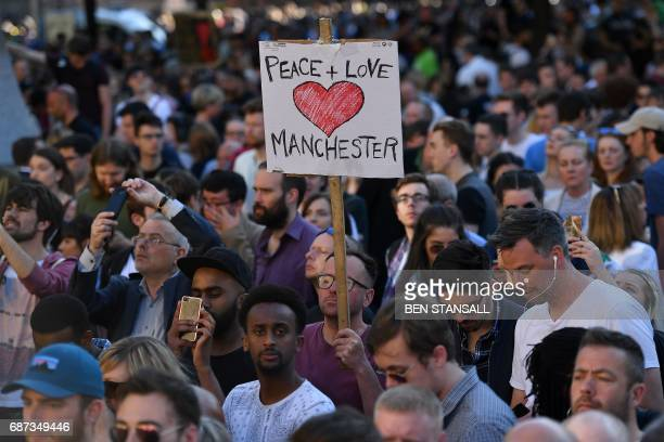 TOPSHOT People attend a vigil in Albert Square in Manchester northwest England on May 23 in solidarity with those killed an injured in the May 22...