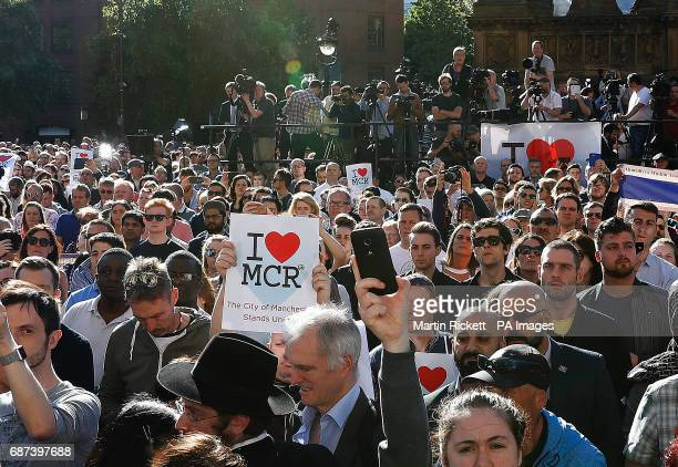 People attend a vigil in Albert Square Manchester after a 23yearold man was arrested in connection with the Manchester concert bomb attack