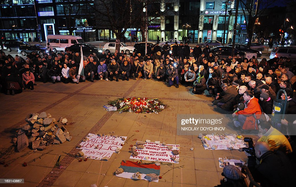 People attend a vigil on March 5, 2013 outside the city hall of Varna, on the site where a man who became a symbol of the three-week wave of protests against corruption, set himself on fire. Plamen Goranov, a 36-year-old amateur photographer and rock climber, died on March 3 after setting himself ablaze on February 20 in the Black Sea city of Varna. Goranov's self-immolation prompted Varna protestors to adopt his cause and turn their initial anger over high electricity bills against the long-time mayor, whom they accused of corruption and favouritism towards a local business group.