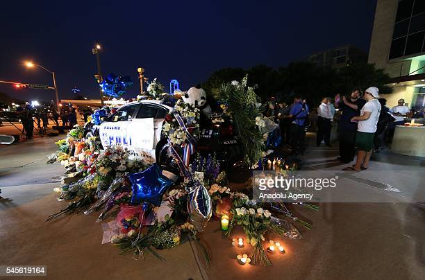 People attend a vigil outside Dallas Police headquarters in Dallas Texas USA 08 July 2016
