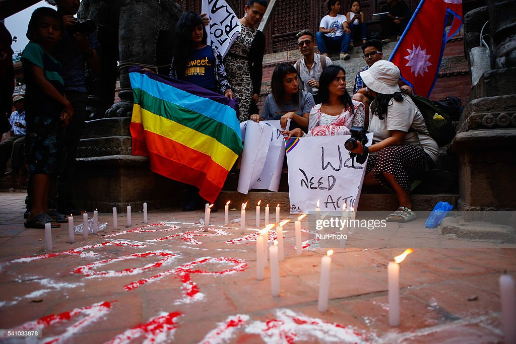 People attend a vigil to pay tribute to the victims of the Pulse gay nightclub mass shooting in Orlando, Florida, in Kathmandu, Nepal, June 17, 2016.