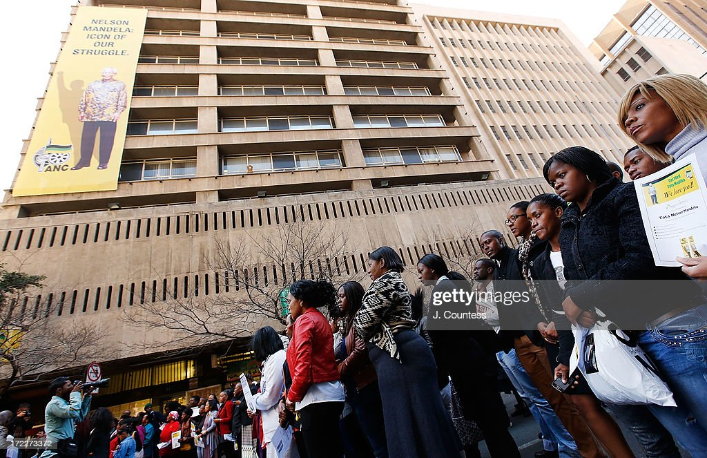 People attend an African National Congress-sponsored prayer rally outside ANC headquarters on July 2, 2013 in Johannesburg, South Africa. The anti-apartheid icon and Nobel Peace Prize Laureate has been in the hospital for more than three weeks being treated for a recurring lung infection.