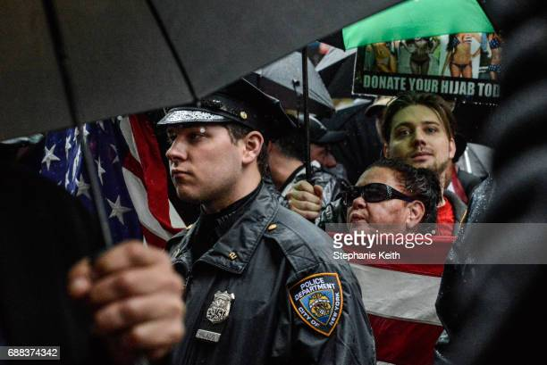 People attend an Alt Right protest of Muslim activist Linda Sarsour on April 25 2017 in New York City