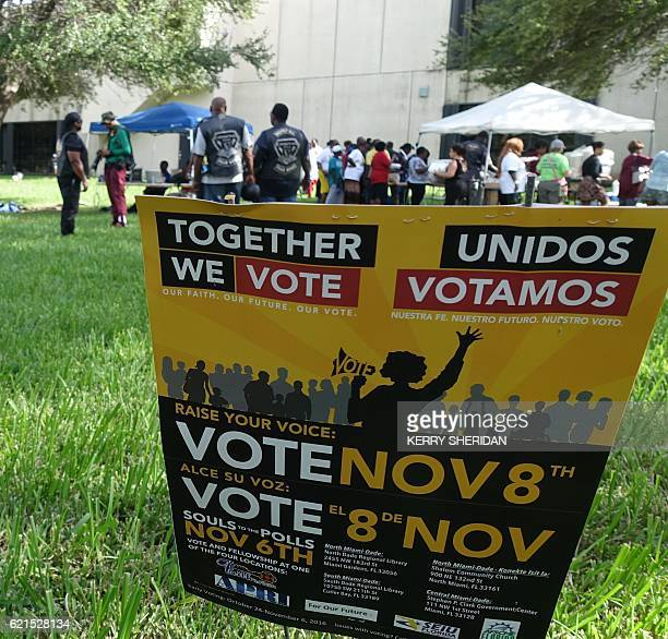 People attend an event called Souls to the Polls on November 6 2016 in Cutler Bay Florida which aims to encourage minority voter turnout in the key...