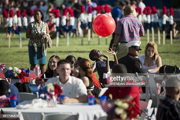 People attend an Independence Day celebration on the South Lawn of the White House July 4 2014 in Washington DC AFP PHOTO/Brendan SMIALOWSKI