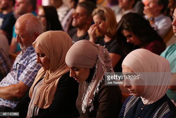 People attend an Interfaith Prayer Vigil at Olivet Baptist Church to honor the four Marines killed during a shooting on July 17 2015 in Chattanooga...