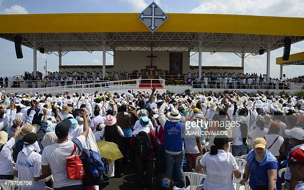 People attend an openair mass officiated by Pope Francis at Samanes Park in Guayaquil Ecuador on July 6 2015 More than a million faithful some of...