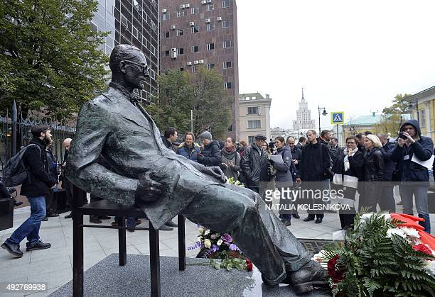 People attend an opening ceremony of the monument to SwissFrench architect CharlesEdouard Jeanneret better known as Le Corbusier in Moscow on October...