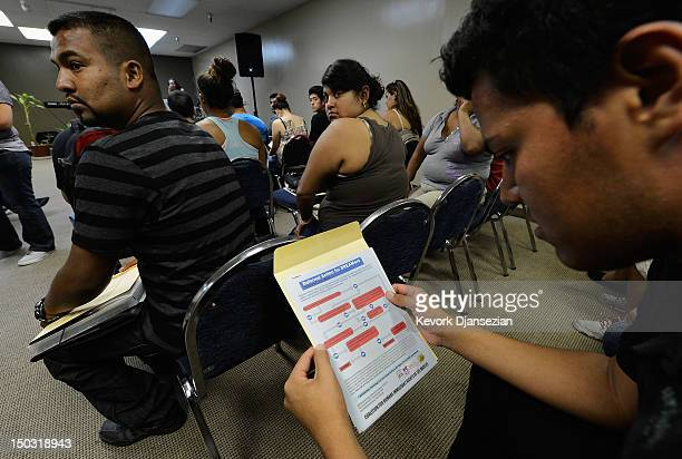 People attend an orientation class in filing up their application for Deferred Action for Childhood Arrivals program at Coalition for Humane...