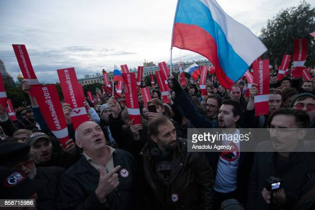 People attend an unauthorized antiKremlin rally called by opposition leader Alexei Navalny who is serving a 20day jail sentence in SaintPetersburg...