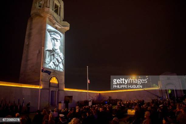 People attend Anzac Day ceremonies at the military cemetery of the Australian National Memorial in VillersBretonneux northern France on April 25...