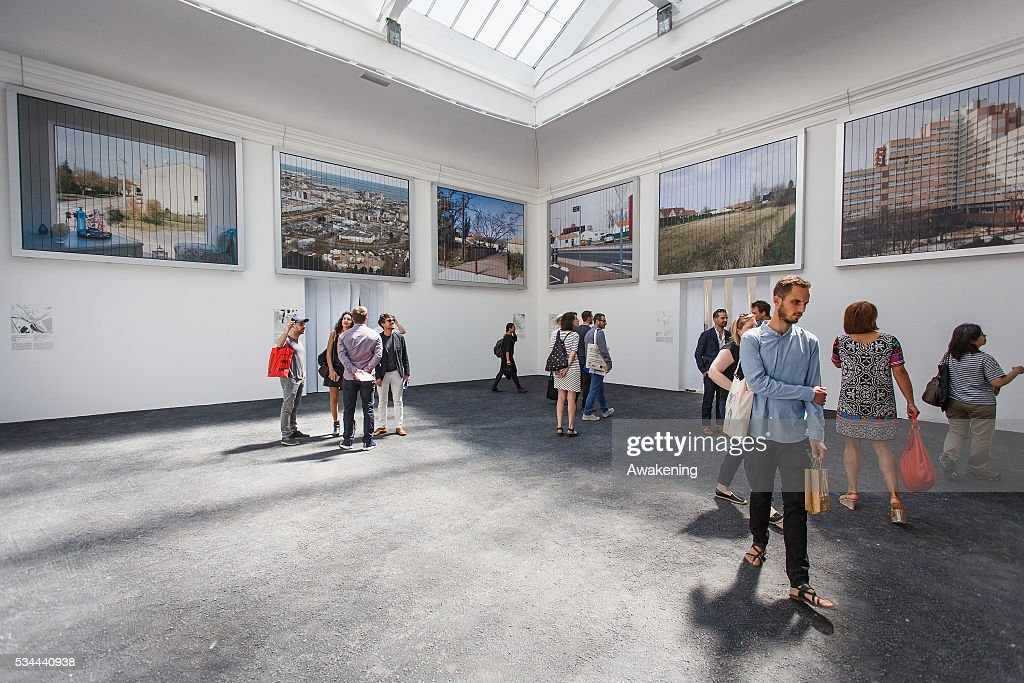People attend at the France Pavillion of the 15th Architecture Venice Biennale, on May 26, 2016 in Venice, Italy. The 15th International Architecture Exhibition of La Biennale di Venezia will be open to the public from May 28 to November 27 in Venice, Italy.