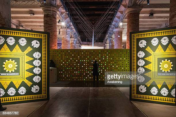 People attend at the Reporting from the Front Pavillion of the 15th Architecture Venice Biennale on May 27 2016 in Venice Italy The 15th...