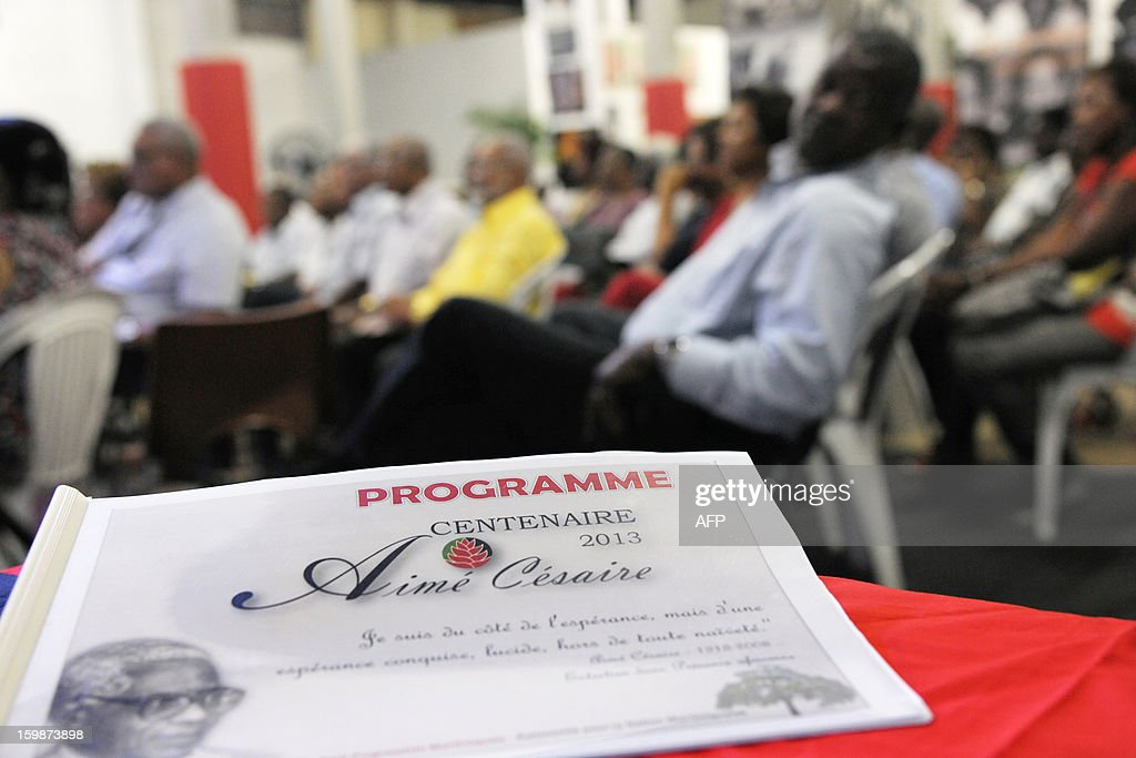 People attend celebrations on January 21, 2013 at the Martinican Progressive Party (PPM) in Fort-de-France, in the French Caribbean island of Martinique, to launch celebrations marking the 100th anniversary of French author and politician Aime Cesaire's birth. French poet Aime Cesaire (June 25, 1913 – 17 April 2008) was former mayor of Fort-de-France and had funded the PPM party in 1958. As a pioneer of the black pride movement, Cesaire was a cult figure on his native island of Martinique and in the French-speaking world. With fellow writers such as Leopold Sedar Senghor of Senegal, 'Papa Cesaire' invented the term 'negritude,' which he defined as an 'affirmation that one is black and proud of it', decades before the emergence of Steve Biko or Martin Luther King. AFP PHOTO JEAN-MICHEL ANDRE