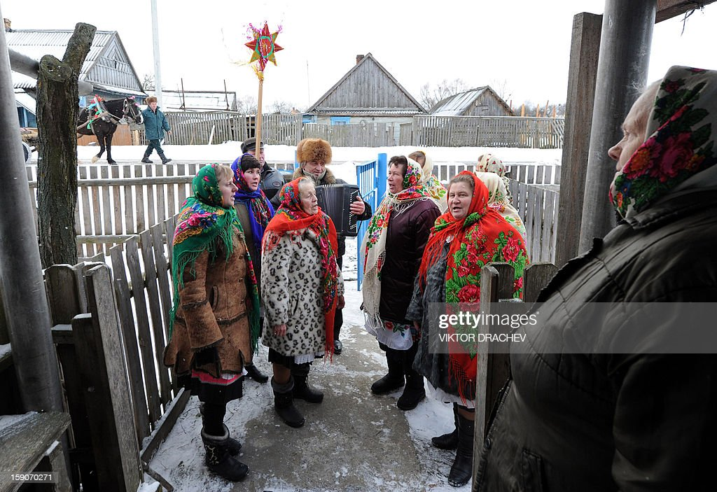 People attend Christmas celebrations in the town of Richev, some 290 km south from Minsk, on January 7, 2013. Orthodox Christians celebrate Christmas on January 7 in the Middle East, Russia and other Orthodox churches that use the old Julian calendar instead of the 17th-century Gregorian calendar adopted by Catholics, Protestants, Greek Orthodox and commonly used attendsin secular life around the world.