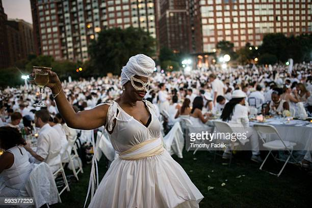 People attend Diner en Blanc a popup dinner held once a year in New York on August 25 2014 in the Battery Park City neighborhood of New York City...