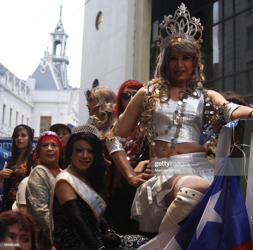 People attend during the gays, lesbians and transvestites pride parade celebration on September 07, 2013 in Valparaiso, Chile.