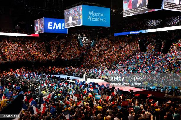 People attend French presidential candidate Emmanuel Macron campaign rally at Bercy Arena on April 17 2017 in Paris France
