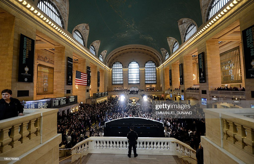 People attend Grand Central Terminal centennial celebrations in New York, February 1 , 2013 . Grand Central Terminal, the doyenne of US train stations, is celebrating its100th birthday on February 2, 2013. Opened on February 2, 1913, when trains were a luxurious means of traveling across America, the New York landmark with its Beaux-Arts facade is still one of the US largest transportation hubs and is also theNew York's second-most-popular tourist attraction, after Times Square. AFP PHOTO/Emmanuel Dunand