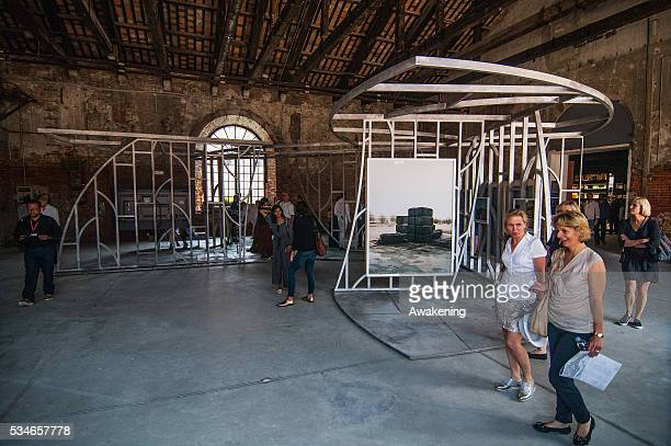 People attend Kingdom of Bahrain Pavilion of the 15th Architecture Venice Biennale on May 27 2016 in Venice Italy The 15th International Architecture...