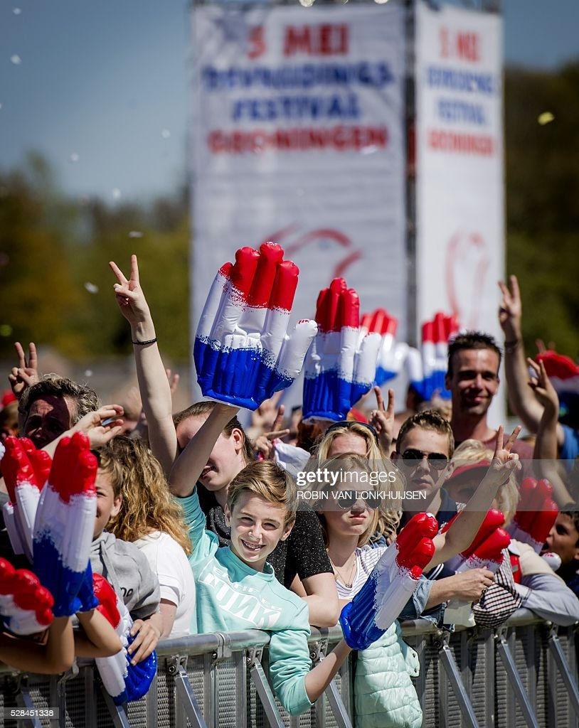 People attend Liberation Day (Bevrijdingsdag) celebrations in Groningen, The Netherlands, on May 5, 2016, to mark the end of Nazi occupation during World War II. / AFP / ANP / Robin van Lonkhuijsen / Netherlands OUT
