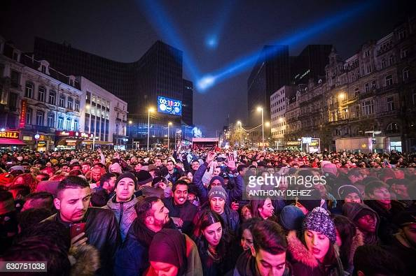 People attend New Year's eve festivities on December 31 ...