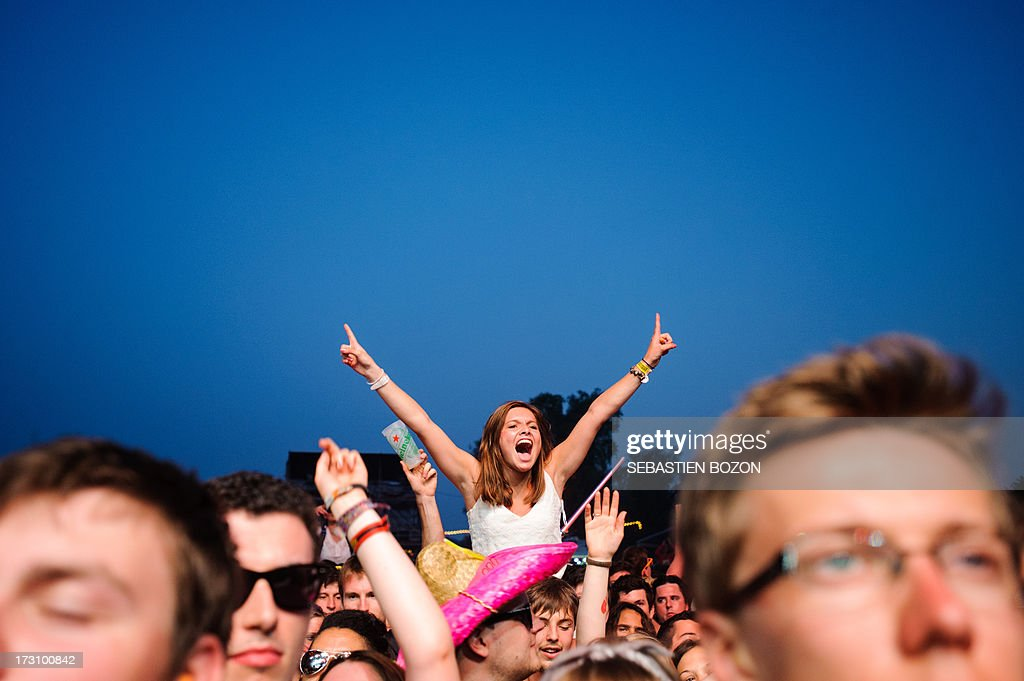 People attend on July 6, 2013 the Eurockeennes festival in the eastern French city of Belfort.