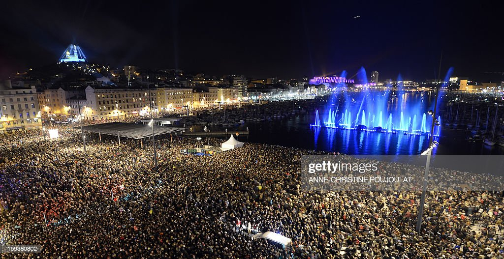 People attend on the Old Harbour in Marseille on January 12, 2013 in Marseille during the beginning and launch of festivities for the Marseille-Provence 2013 European Capital of Culture. The event marks the start of a year, leading to a cultural renaissance in France's second-largest metropolitan area.
