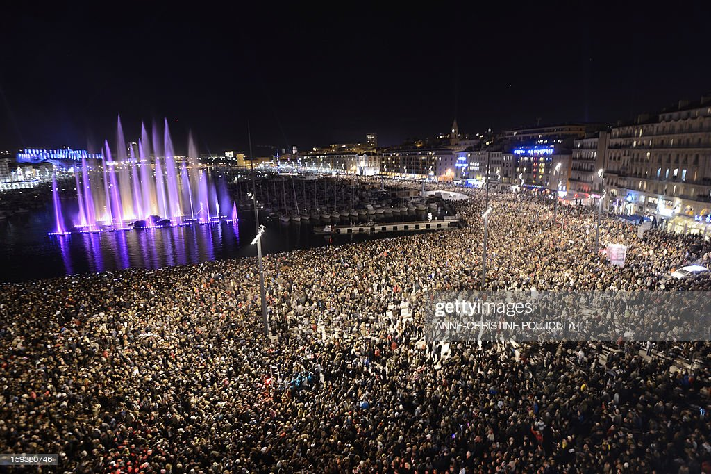 People attend on the Old Harbour in Marseille on January 12, 2013, during the beginning and launch of festivities for the Marseille-Provence 2013 European Capital of Culture. The event marks the start of a year, leading to a cultural renaissance in France's second-largest metropolitan area.