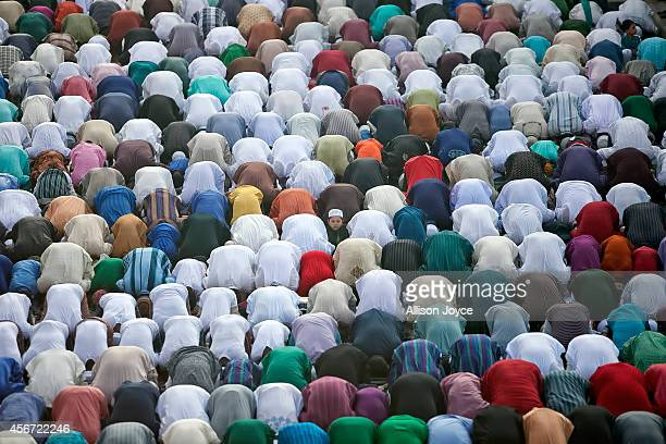 People attend prayer outside the National Mosque during the EidalAdha holiday October 6 2014 in Dhaka Bangladesh Eid AlAdha known as the 'Feast of...
