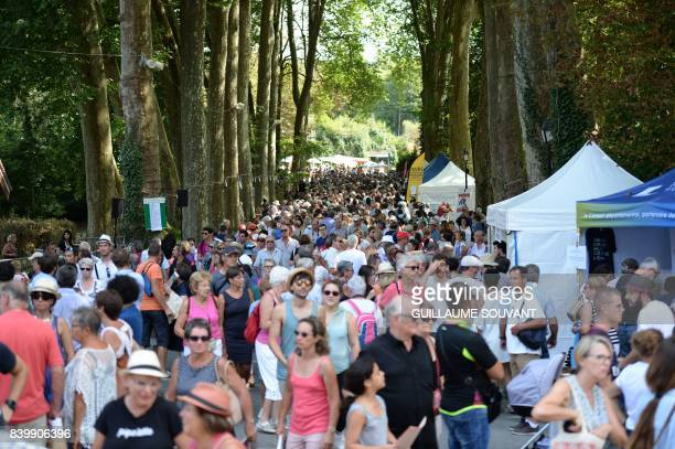 People attend the 22th La Foret Des Livres book fair on August 27 2017 in ChanceauxpresLoches central France La Foret Des Livres book fair was...