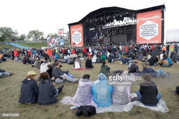 People attend the 82nd edition of the annual 'Fete de l'humanite' music festival organized by French newspaper L'Humanite in La Courneuve near Paris...
