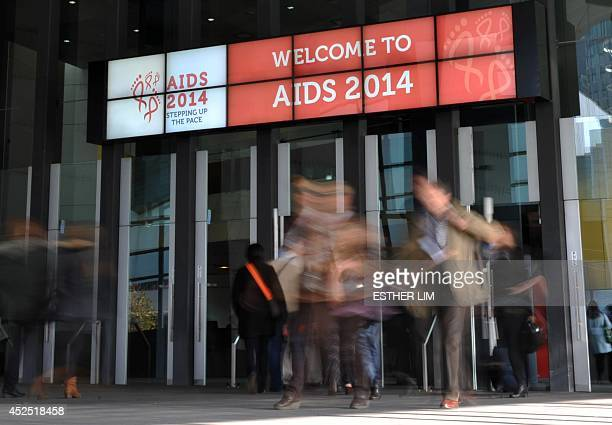 People attend the AIDS Conference 2014 at the Melbourne Convention and Exhibition Centre in Melbourne on July 22 2014 The elusive quest for an HIV...