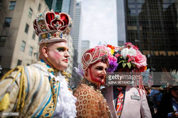 People attend the annual Easter Parade and Easter Bonnet Festival on the Fith avenue April 16 2017 in New York / AFP PHOTO / KENA BETANCUR