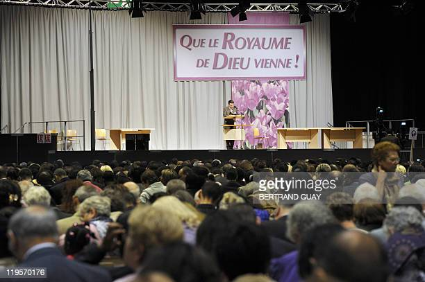 People attend the annual Jehovah's Witnesses assembly gathering 30000 believers on July 22 2011 in Villepinte Paris suburb European rights judges...